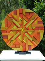 geometric timber mandala sculpture sun side